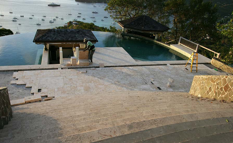 100a-Laying-the-natural-non-slip-coral-tiles-on-the-pool-patio-and-steps