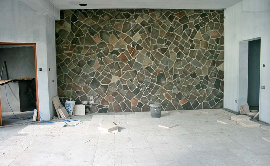 192-The-Ocean-bedroom-complete-with-a-stone-clad-wall-and-coral-tile-floor