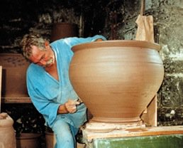Mike Goddard at Studio Pottery creating one of his garden pots