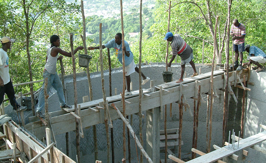 38h-Pouring-the-concrete-support-beams-for-the-cottage